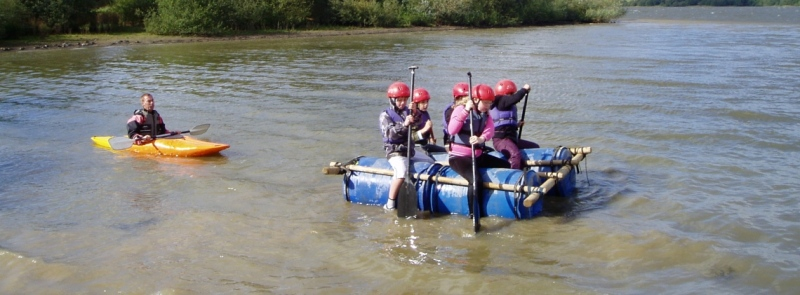 Group learning about teamwork on school trip